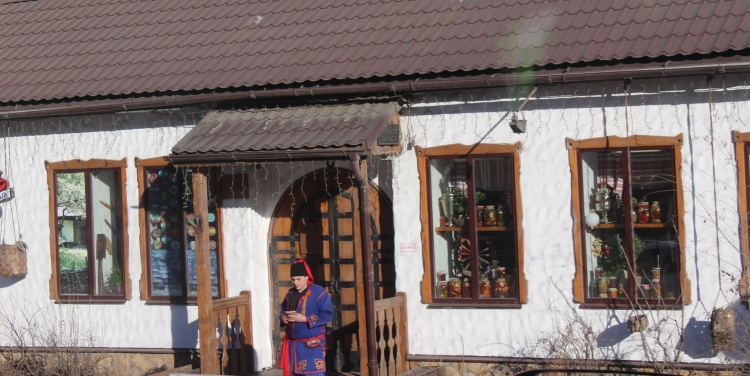 A local in the traditional Russian attire on Old Arbat Street