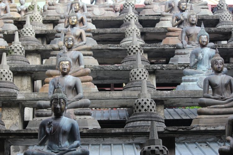 Buddha statues adorn the premise of the Gangarama Temple in Colombo