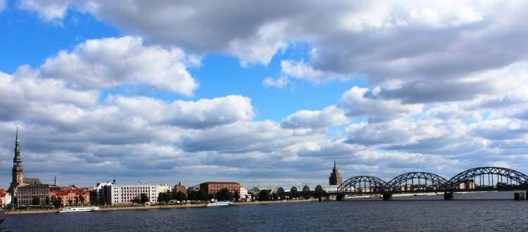 Riga's cityscape breaks the blue monotone of the river and the sky