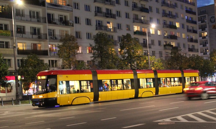 Modern trams run noiselessly through the night