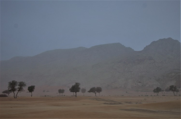Hajar Mountains separate the sky from the desert